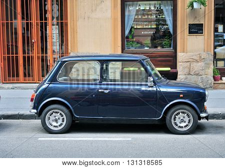 BUDAPEST HUNGARY - MAY 16: Mini Cooper parked in the street of Budapest on May 16 2016. Mini Cooper is a British automotive marque owned by BMW.
