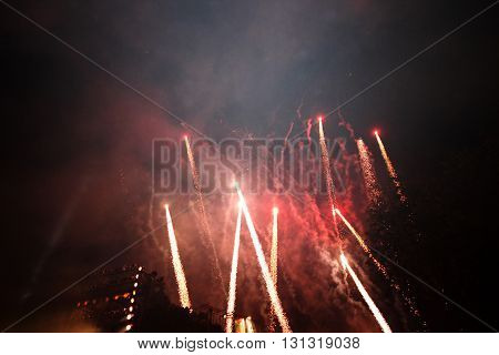 celebration fireworks at night display on the dark sky background