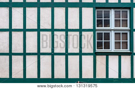 Window On A White Wall With Old Wooden Beams.