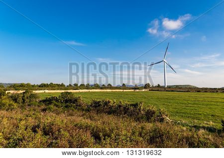 Wind turbines blades on the countryside and a blue sky