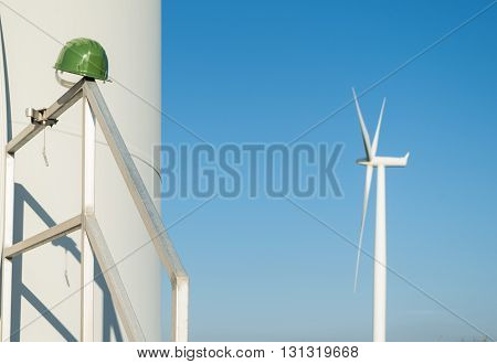 Wind turbines blades on the countryside and a blu sky as background