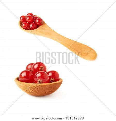 Set of Wooden spoon filled with ripe Red Currant berries isolated over white background