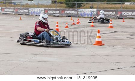 Moscow - August 28 2015: A man in a white helmet rides on the race cart on the racetrack August 28 2015 Moscow Russia