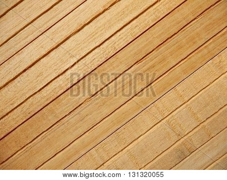 Reverse side of wooden tiles slatted together to be used as ceiling or wall tiles