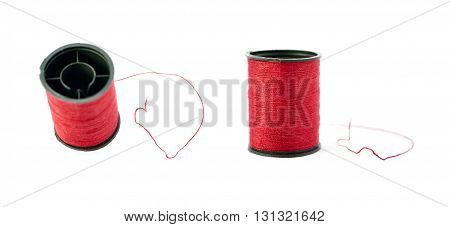 Set of Spool of red thread isolated over the white background