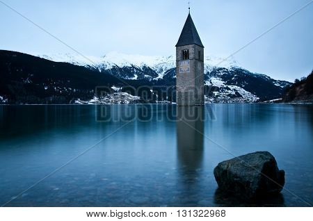 A beautiful view on the tower of the sunken church in the Lake Resia in Tyrol, Italy