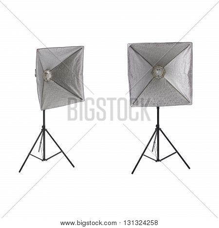 Set ofa studio flash with square softbox on a stand over isolated white background