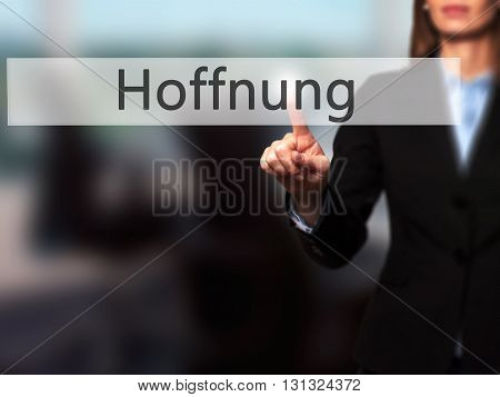 Hoffnung (hope In German) - Businesswoman Hand Pressing Button On Touch Screen Interface.