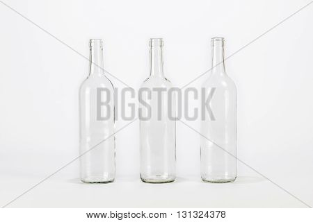 Three empty glass bottle isolated on white background