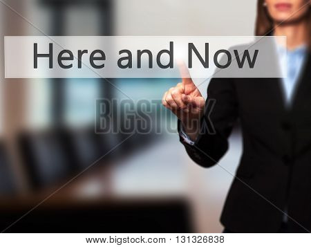 Here And Now - Businesswoman Hand Pressing Button On Touch Screen Interface.
