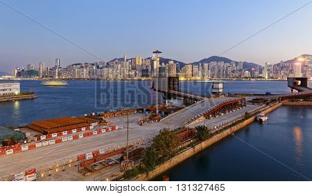 Hong Kong night view of cargo port with reflections at victoria harbor