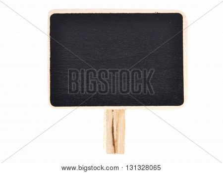Colorful and crisp image of plate of slate for writing with wooden base on white