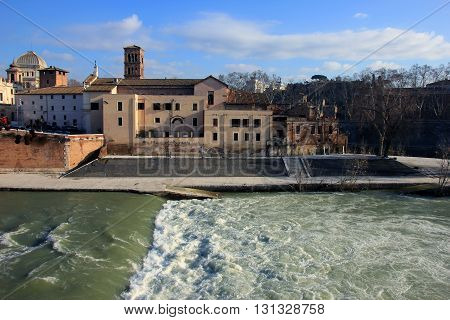 view of hospital Brothers Hospitallers at Tiber island (Isola Tiberina) and river water in Rome Italy