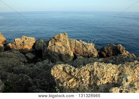 rocks and blue sea - rocky turkish shore of mediterranean sea Alanya Turkey