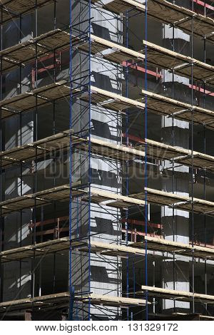corner of concrete building under construction with scaffolding in Moscow Russia