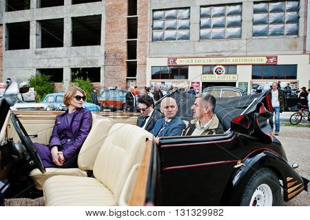 Podol, Ukraine - May 19, 2016: People Sitting On Maybach Roadster Cabriolet, Luxury Classic Car.