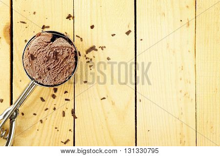 chocolate ice cream scoop on wood with empty space