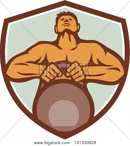 Illustration of an athlete weightlifter looking up lifting kettlebell with both hands viewed from front set inside shield crest on isolated background done in retro style.