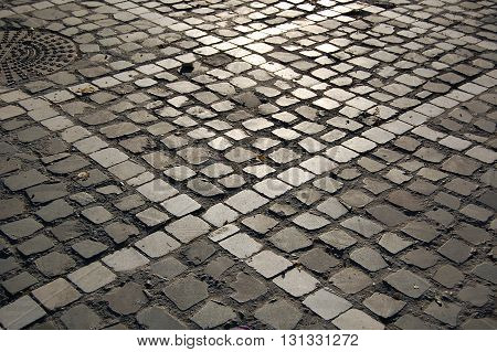 Beautiful sunset light on patterned cubic pavement