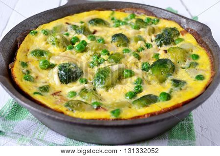 Frittata with cheese green peas and Brussels sprouts