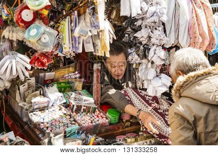 Chinese Man In His Market Stall Sells Tailor Equipments