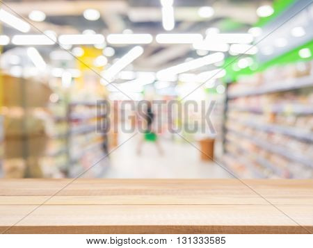 Wooden Empty Table In Front Of Blurred Supermarket