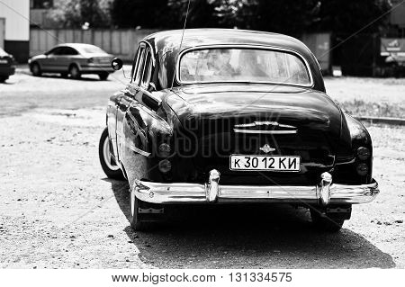 Podol, Ukraine - May 19, 2016: Back View Of Goes On Road Gaz-12 Zim, Luxury Soviet Limousine. Black