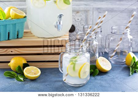 Fresh citrus lemonade with lemons in beverage dispenser