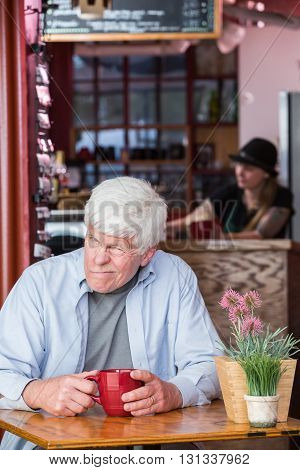 Grumpy Mature Man In Coffee House