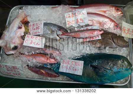 Different fish on ice for sale on the market in Okinawa, Japan.