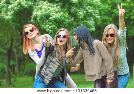 Happy friends posing together on a summers day