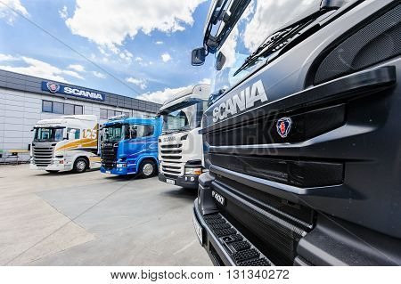 KIEV,UKRAINE - May,21 : Scania sign on truck hood and other different types of trucks in courtyard of service center in Kiev,Ukraine May 21,2016.