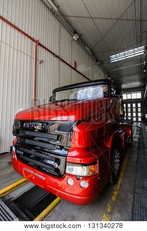 KIEV,UKRAINE - May,21: Red Pearl  Scania R999 by Svempas Customs  in repair hangar during the celebration of 125 anniversary of Scania company in Kiev,Ukraine May 21,2016.