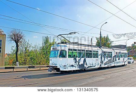 VINNYTSIA, UKRAINE - MAY 03, 2013: Old tram on a street in Vinnytsia, Ukraine