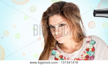 blond girl with hair dryer in hand