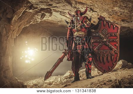 Powerful Knight In Heavy Armor With The Sword And Shield