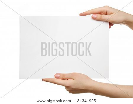 Female hands holding blank sheet of paper isolated on white