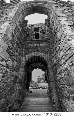 Looking through the doorway of a ruined Scottish Castle