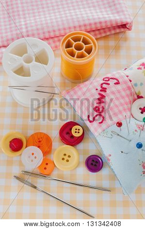 Home sewing items needles buttons and threads