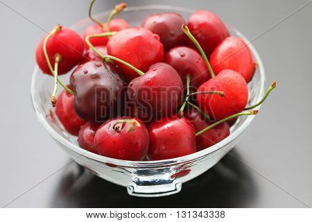 Fresh cherries in bowl on table.  Ripe red cherry berries. Sweet cherries.