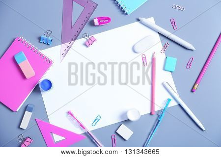 Set of stationery on grey table, top view