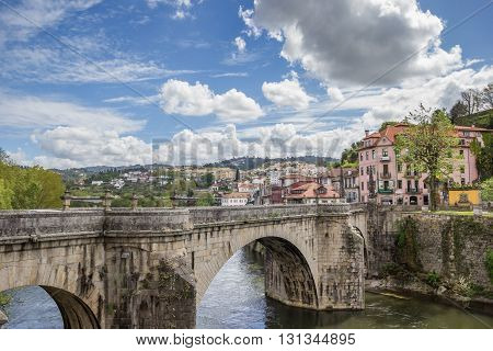 AMARANTE, PORTUGAL - APRIL 22, 2016: Old Roman bridge over river Tamega in Amarante, Portugal