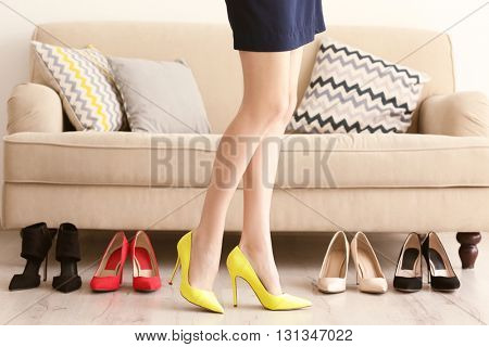 Woman choosing right shoes.