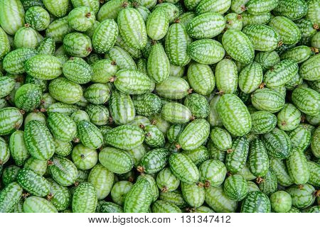 Fresh cucamelon (Melothria scabra) background texture. Top view.