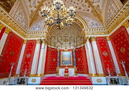 SAINT PETERSBURG RUSSIA - JULY 11 2015: The State Hermitage Museum St George's Hall is Great Throne Room and one of the largest state rooms on July 11 2015 in the Winter Palace St Petersburg.