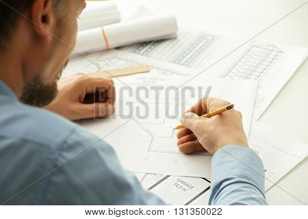 Male construction engineer working in the office