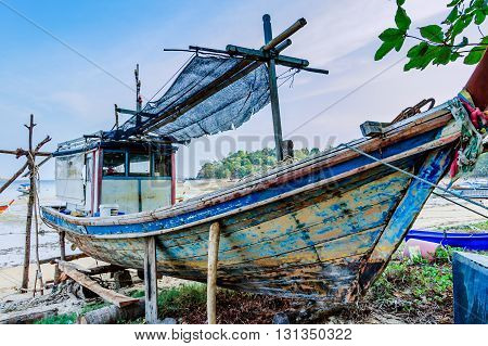 Fishing boat on beach for repairs Phuket southern Thailand