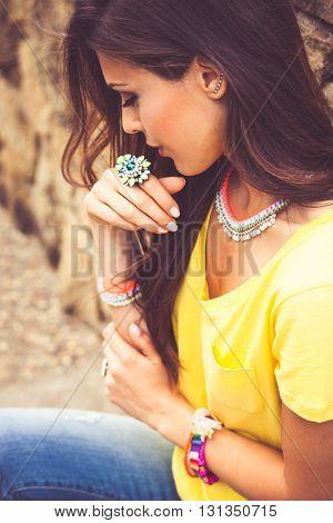 urban fashion summer girl portrait wearing large ring