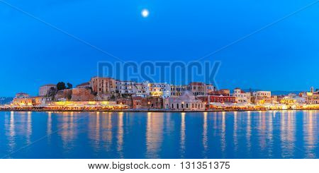 Panoramic view of Venetian quay of Chania with Kucuk Hasan Pasha Mosque during twilight blue hour, Crete, Greece