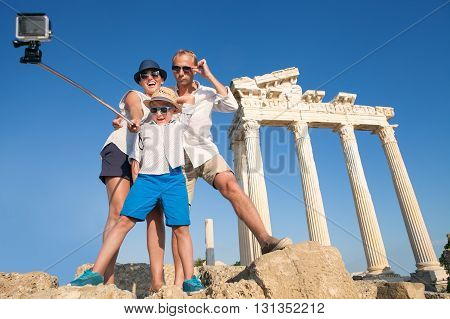 Family take a selfie video on the antique colonnade viewю Temple of ApolloSideTurkey